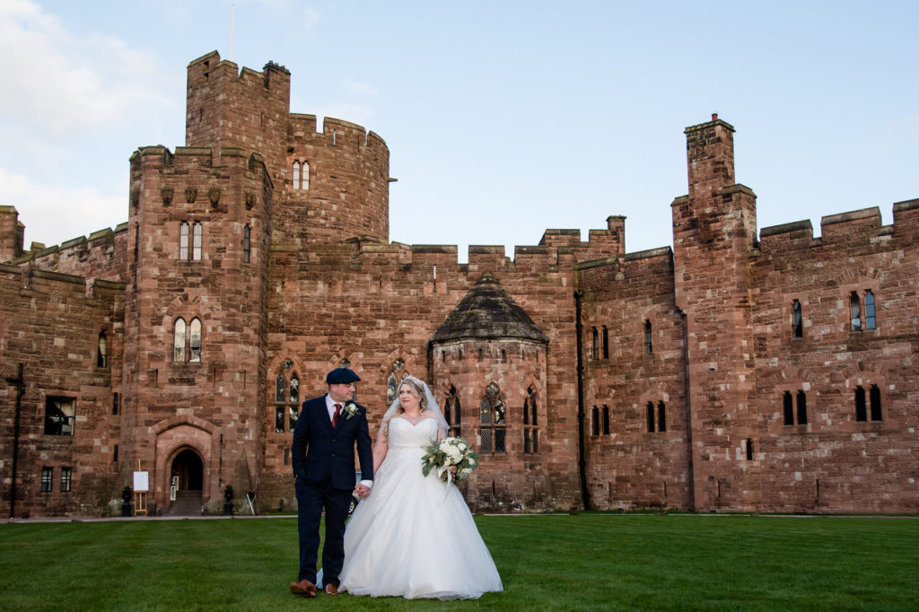 Peckforton wedding video walking on lawn